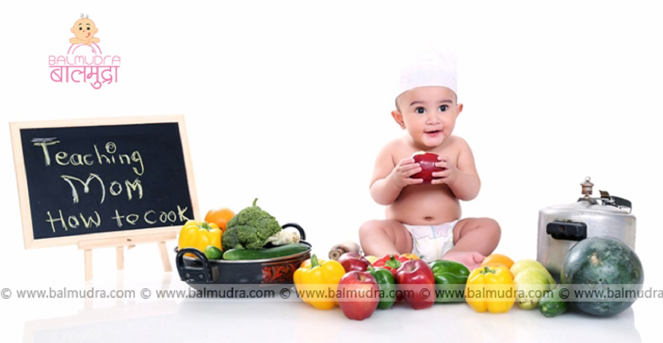 Baby chef busy during his professional photo shoot in balmudra