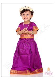 Baby girl wearing fresh White flowers crown during her photo shoot in Balmudra Studio Pune