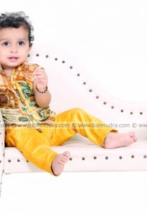 Baby sitting on a sofa in Balmudra Studio for Photo Shoot