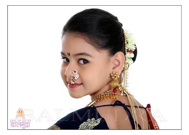 208d4850f4 Closeup of Very Cute beautiful Indian girl in traditional sari dress and  Jwellery PhotoShoot Portfolio done in Balmudra Studio Pune.jpg