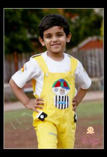 Cute Boy in a Yellow Dangari posing for Camera