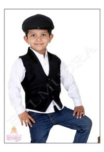 Cute Boy wearing a Black cap and posing for camera during hos photoshoot in Balmudra Studio Pune