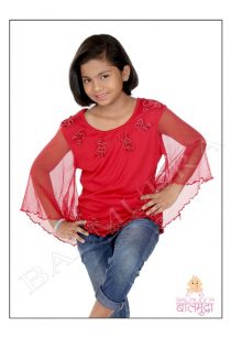 Cute girl posing for camera during her photo session in Balmudra Studio Pune