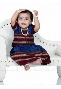 Cute little girl in traditional dress sitting on a sofa , #BestBabyphotographer# BestChildPhotographer# Babymodellinginpune# Infantphotoshootinpune# FamilyPhotographer# ToddlerPhotography# Newbornbabyphotoshoot# BestBabyportfolio# Kidsphotographyinpune# BestPhotostudiosinpune# Maternityphotoshoot# ChildModellinginPune#Pune#babiesPhoto#babynames#photography#babymodelsinindia#shrikrishnaparanjpephotography#bamudraphotography# www.balmudra.com#cutebabyphotos#BestbabyphotographerinIndia#BestbabyphotographerinPune#BabyphotoshootIdeas# Puneauditions#casting#babyadvertising#modelcoordinatersinpune#crawlingbaby#sitter#crawler#babyphotothemes#Smiling#Cute#Lovely#Indoor#outdoorphotoshoot