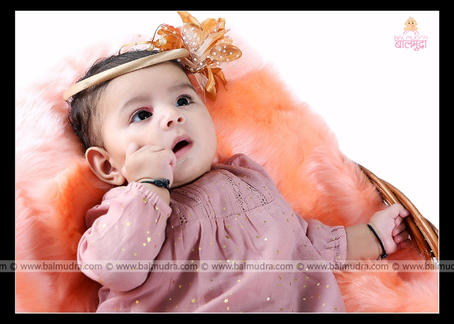 Cute Indian Baby Wearing a Fashionable & Cute Peach color Hair Band during her Professional Photo Session in Balmudra Studio , Pune Shoot done by , Shrikrishna Paranjpe , 9822284771 ,www.balmudra.com
