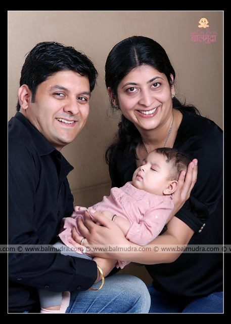 Happy young family of mother, father and Four Months baby Photo Shoot done by ,Shrikrishna Paranjpe , Balmudra Studio - Pune - 9822284771 - www.balmudra.com