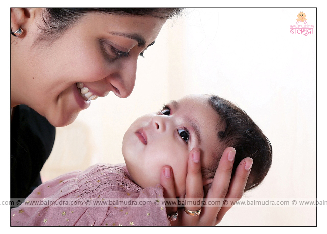 Mother & child , Wonderful photo of Proud Mother and her infant. Photo Shoot done by , Shrikrishna Paranjpe , Balmudra Studio - Pune - 9822284771 - www.balmudra.com