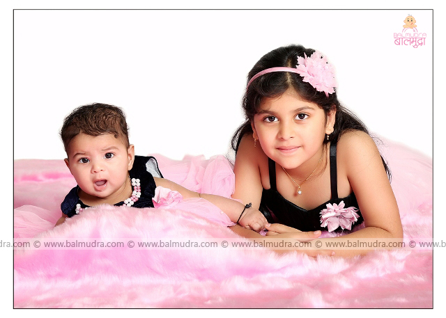 Two Sisters Smiling during Professional Photo Shoot in Balmudra Studio , Pune , by Shrikrishna Paranjpe , 9822284771 , www.balmudra.com