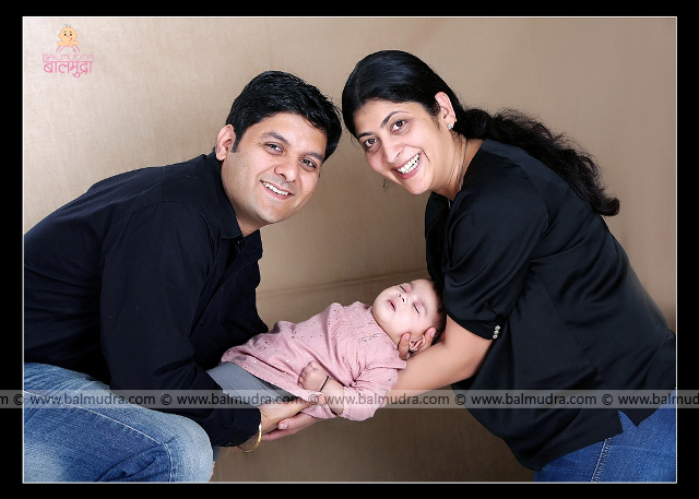 Very Happy young family of mother, father and newborn baby , Photo Shoot done by , Shrikrishna Paranjpe , Balmudra Studio, Pune , 9822284771 ,www.balmudra.com