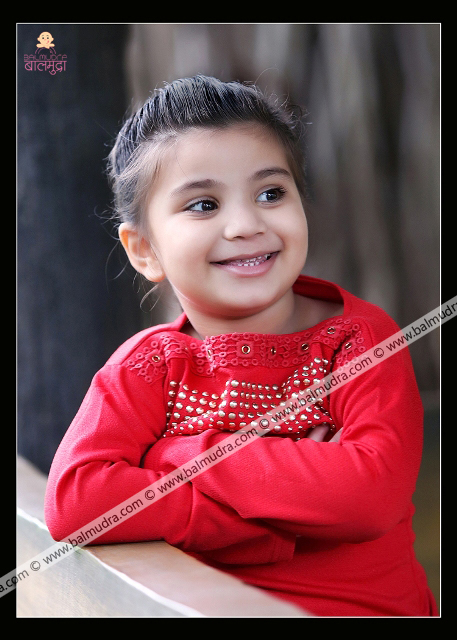 4 Years Old Indian Cute Girl Smiling in Red Dress Professional Portfolio Photo Session in Balmudra Studio Pune