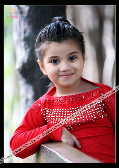 4 Years Old Indian Cute Girl in Red Dress Professional Portfolio Photo Session in Balmudra Studio Pune
