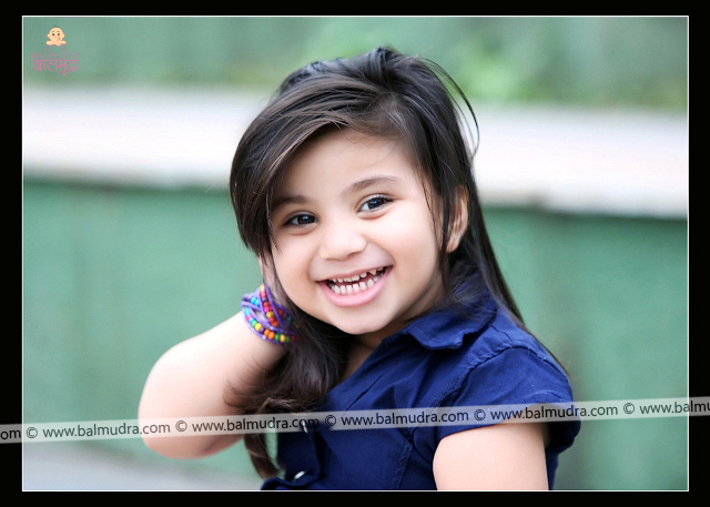 Four Years Cute Girl Smiling during her Outdoor Photo Shoot Professional Portfolio Photo Session in Balmudra Studio Pune