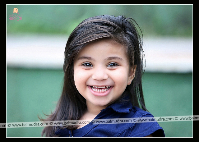 Four Years Indian Girl Smiling during her Outdoor Photo Shoot Professional Portfolio Photo Session in Balmudra Studio Pune