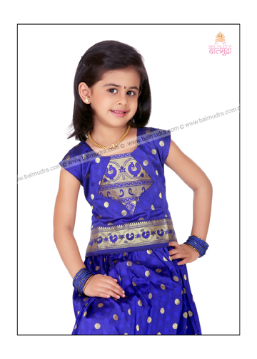 Little Girl Posing for Camera in Balmudra Studio.jpg